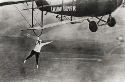 Image Showing Lillian Boyer hangs from the wing of an Aeroplane