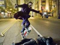 Image about Joker Heath Ledger Skating Over Batman Christian Bale
