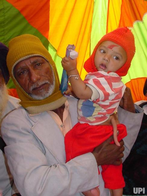 Image of Muslim baby born with tail in Kharar, India