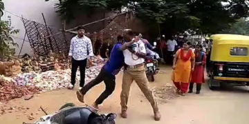 Image about Man Thrashes Traffic Cops for Issuing a Huge Challan