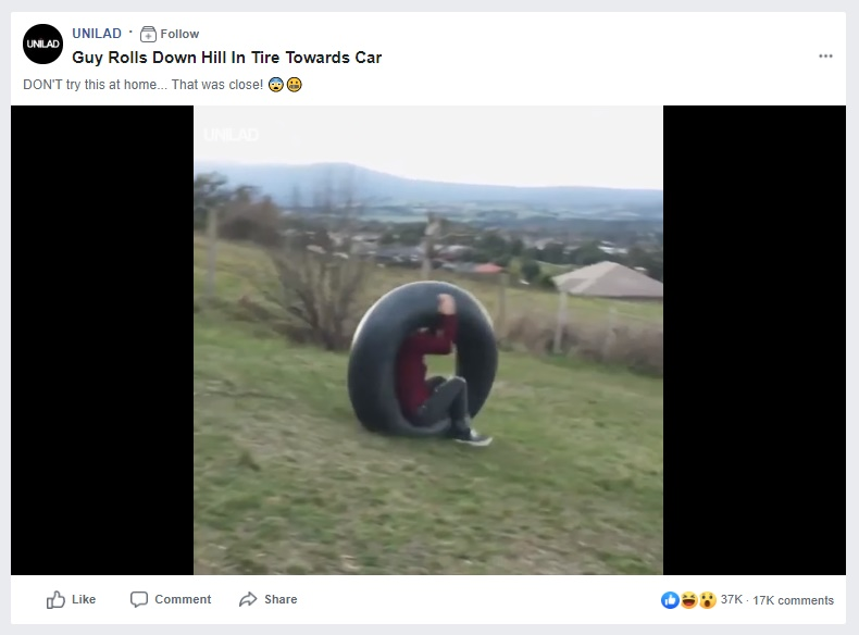 Image about Guy Rolls Down Hill in Tire Towards Car, Video