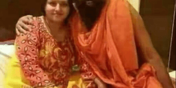 About Photograph of Baba Ramdev with a Woman on Bed