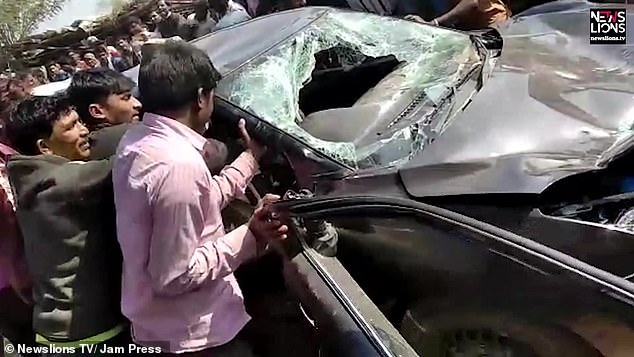 Image of The villagers attacking the car of farmers