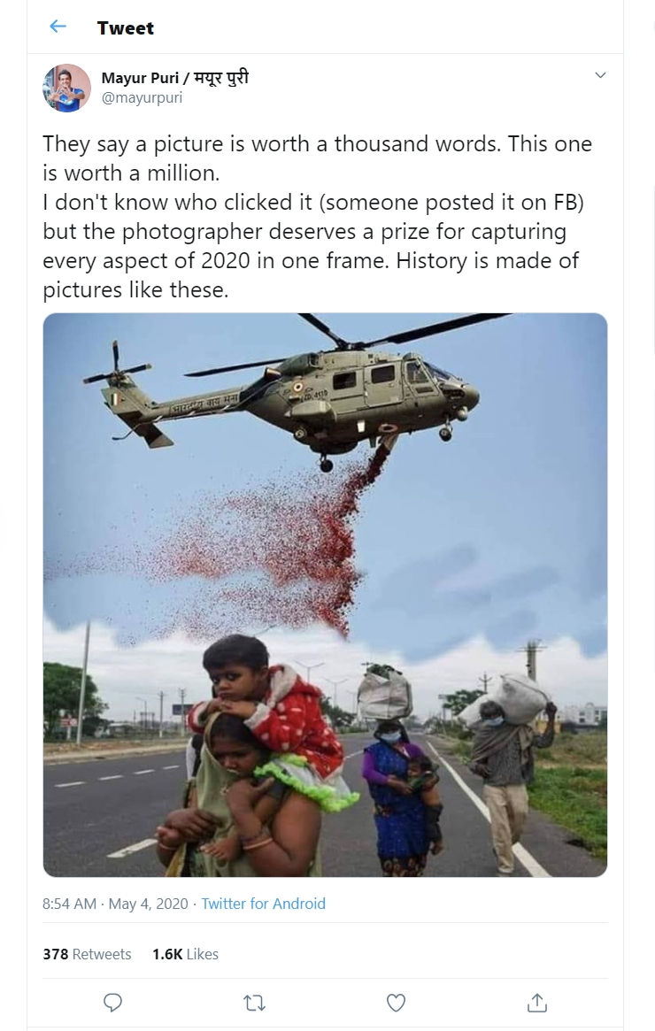 Image about IAF Helicopter Showers Petals on Migrant Workers, Photograph