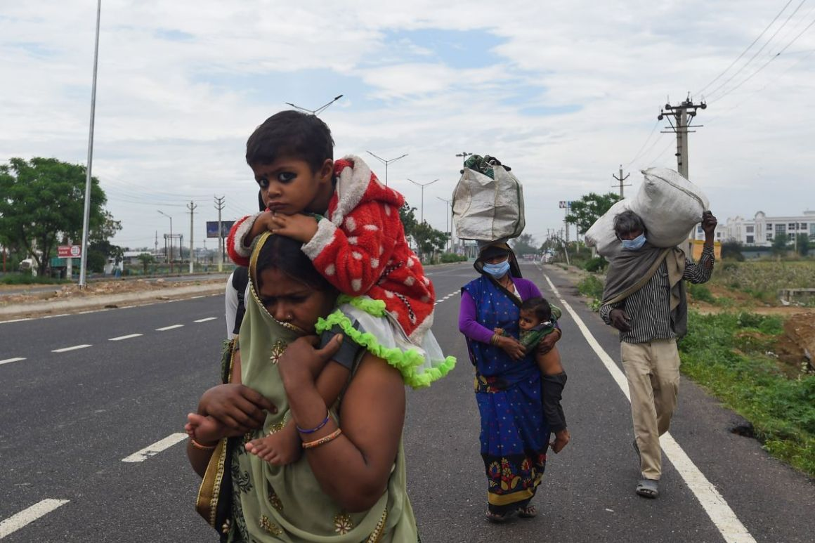 Image of Migrant workers walking back on a highway towards Uttar Pradesh amid Coronavirus lockdown