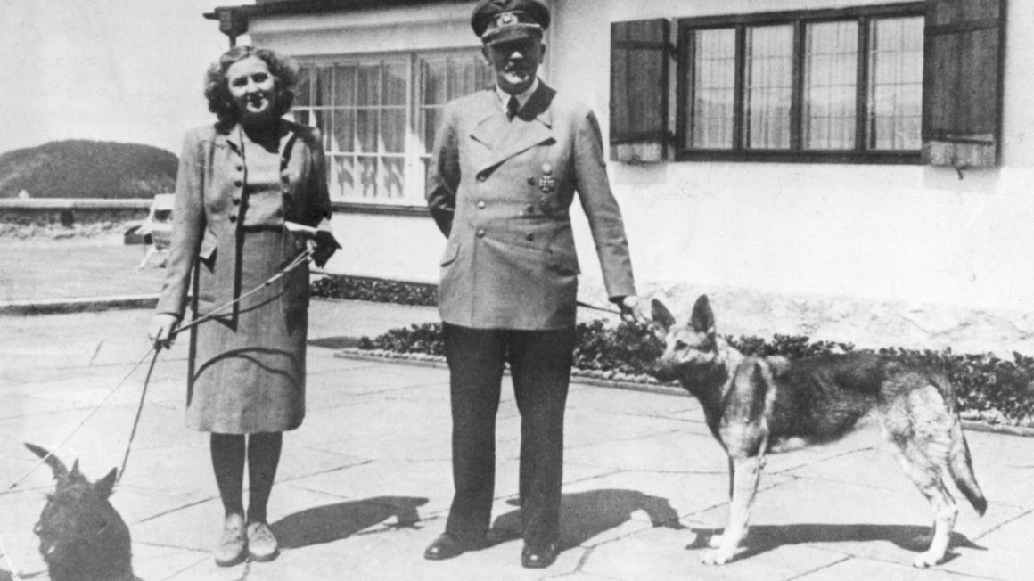 Image of Hitler and his wife Eva Braun with their dogs
