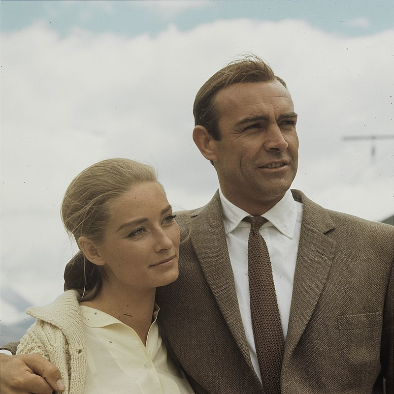 Image of Connery as Bond (with co-star Tania Mallet) while filming Goldfinger in 1964