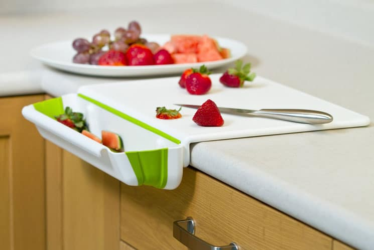 Counter edge poly cutting board with integrated removable bin