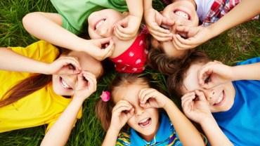 Children form circular hands.