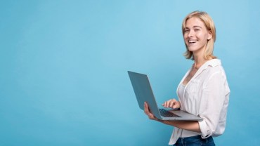woman is holding a laptop