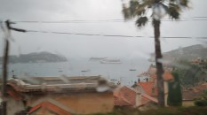 Our ship out in the rainy distance