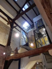A spiral staircase and a glass elevator
