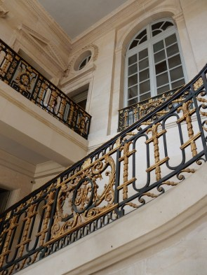 Gilded, iron stair rails are all the rage