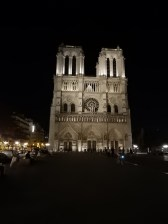 In the courtyard looking at Notre Dame at night