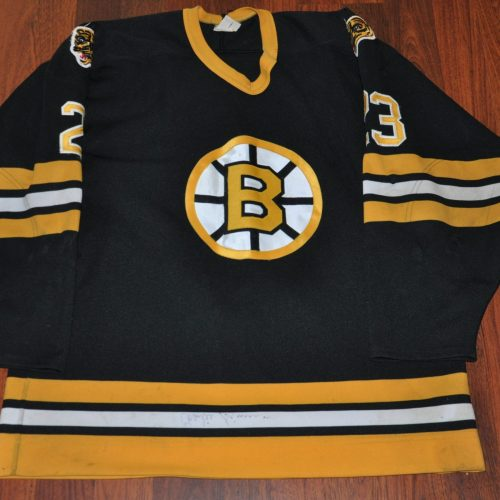 Vintage Boston Bruins. #23 Charlie Simmer. Knit CCM. Jersey shows good repairs. Autograph on lower hem. Coming soon.