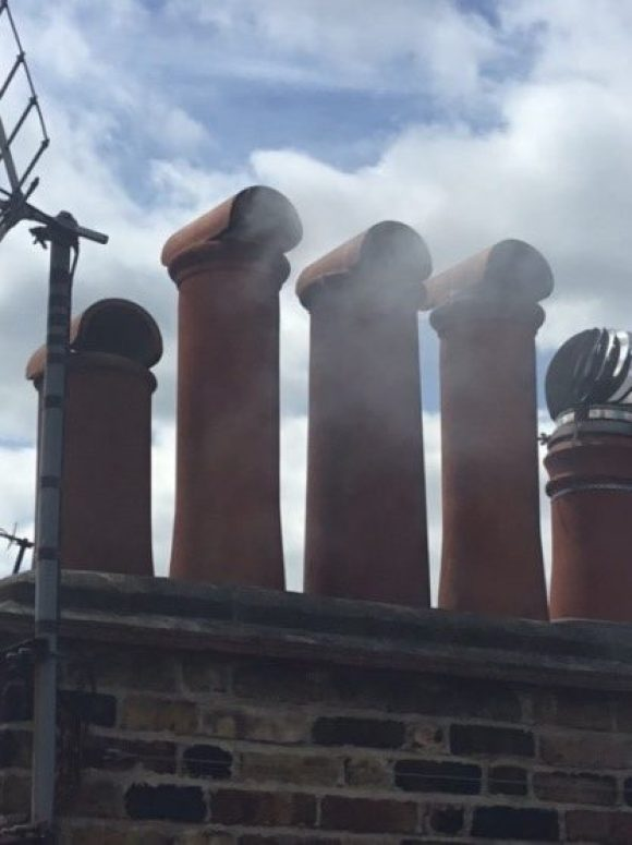 Chimney sweeping in exeter, checking the smoke on cannon chimney pots. Hodgsons chimney sweeps noticed the terminals are incorrect