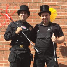 Danny and Daniel Hodgson master chimney sweep devon and torquay. Both wearing top hats and chimmey sweeping tunics. Snaplok brushes and rods