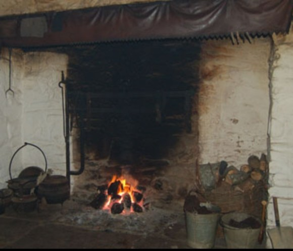 A traditional irish hearth similar the that of an inglenook