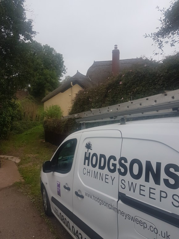 Hodgsons Chimney Sweeps undertaking regular service and maintenance at a thatch property in Dartmouth