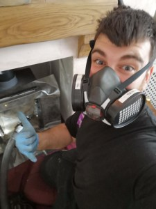 Mr Danny Hodgson undertaking a Chimney Sweep and Stove Service in Axminster