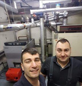 Danny and Daniel Hodgson of Hodgsons Chimney Sweeps undertaking oil boiler fault diagnostics for a  large 750kw oil boiler system