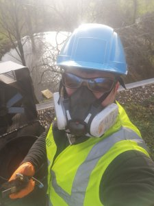 Mr Danny Hodgson working on a roof servicing a chimney fan, with full PPE and Full Arrest Harness