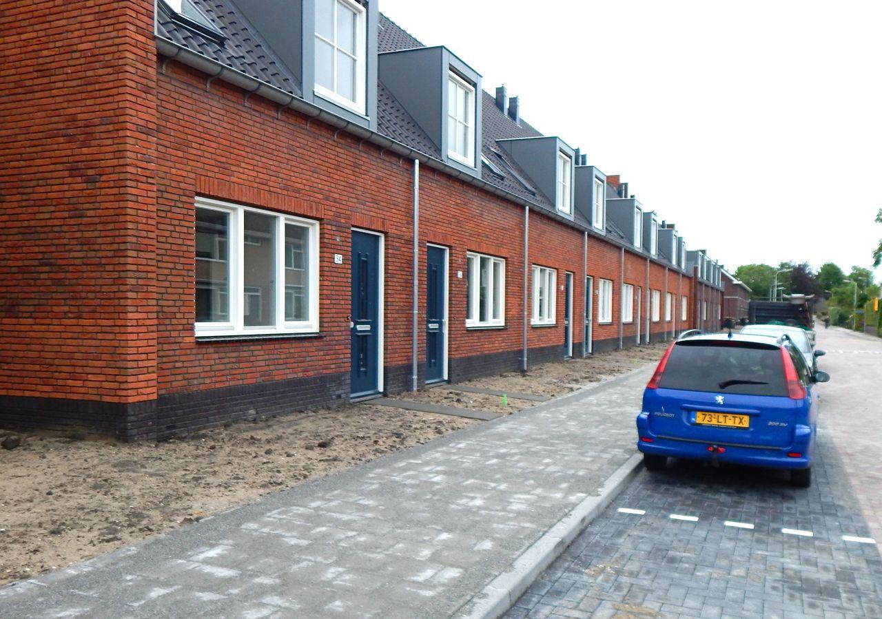 Eerste sleutel voor bewoners nieuwbouw Groene Kruisstraat in 's ...