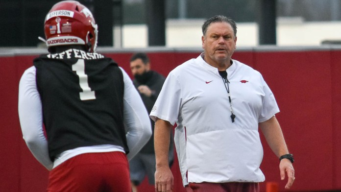Playing toughest schedule makes hill taller for Hogs' improvement