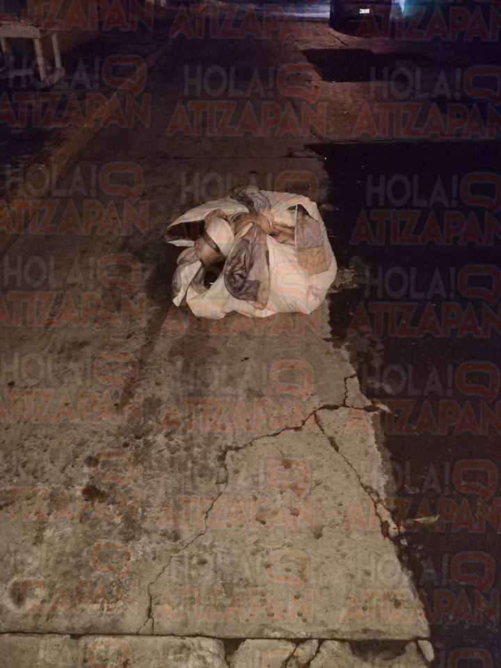 """""""buenos días hoy en la mañana encontramos un vuelto al parecer e un cuerpo en primera cerrada de San Juan colonia San Miguel xochimanga""""(SIC)"""