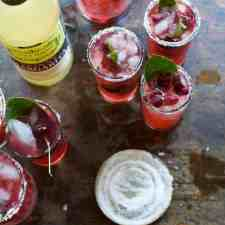 This skinny cherry margarita made with fresh sweet cherries and fragrant lime leaves is a cocktail you can sip on all summer and not feel an ounce of guilt.