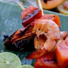 These spicy papaya lime shrimp skewers are the perfect summertime grilled skewer. Small bites of lime and chili marinated shrimp with juicy papaya.