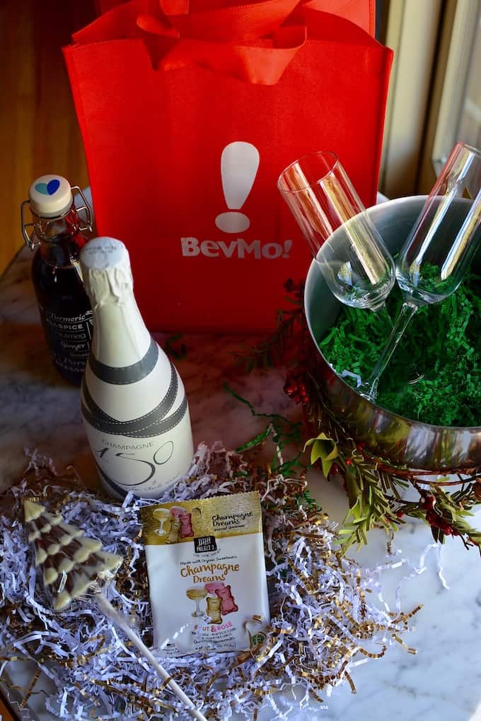 Hibiscus Mimosa Kits: Champagne, homemade hibiscus syrup, and sweet treats wrapped up in an ice bucket makes a lovely hostess gift for ladies who brunch.