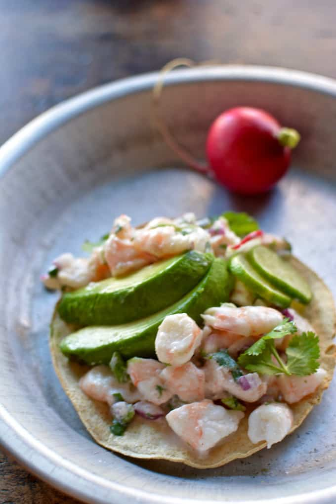 A super easy, ultra healthy shrimp ceviche tostada recipe with fresh squeezed lime juice, coconut milk, chiles, cilantro, and thinly sliced scallions.
