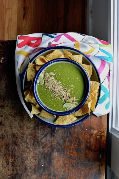 Homemade Salsa Verde is about the easiest thing in the world to make. Blended tomatillos, onion, jalapeños, and cilantro is all it takes to make a swoon-worthy salsa your friends will die for. #salsaverde #tomatillosalsaverde #homemadesalsaverde