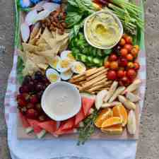 Platter ideas abound but this Pool Party Platter is the best way to satisfy poolside grazing with lots of fresh fruit, veggies, dips, crunchy snacks, and energy-boosting nibbles like cheese, nuts, and hard-boiled eggs. #partyplatter #poolparty #platterideas #summerparty #healthysnacks