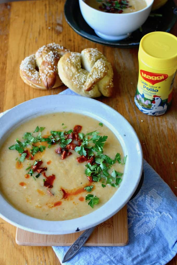 This creamy root vegetable, roasted garlic, and ginger soup actually has no cream whatsoever. It gets topped with a Spanish chorizo-jalapeño relish and is fancy enough for holiday celebrations yet easy enough for weeknight dinners. #ad #rootvegetablesoup #healthysoup #easysoup #fallsoup #dairyfreesoup #rootvegetables #chorizo