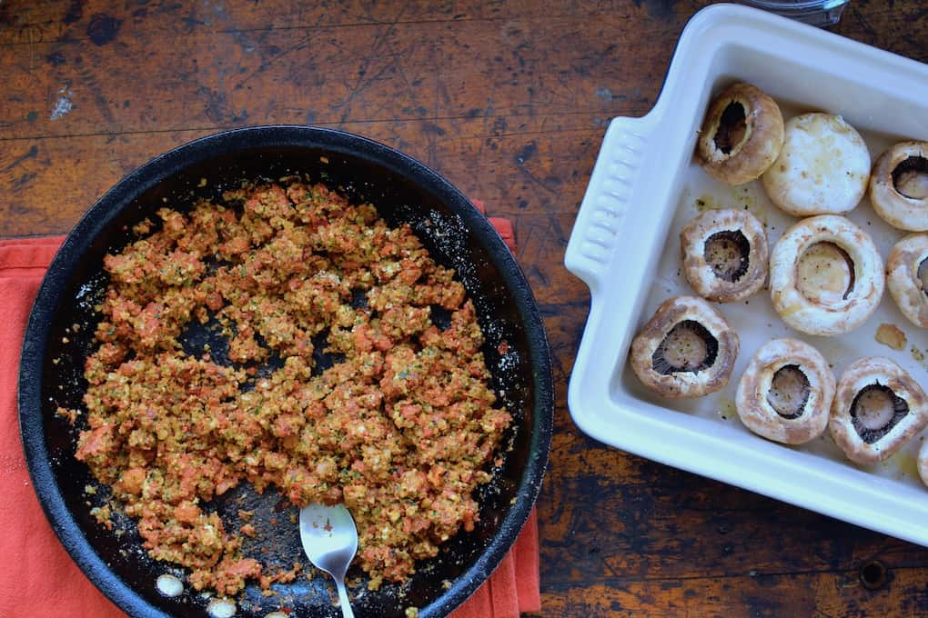 Theses Chorizo and Walnut Stuffed Mushrooms use walnuts and cheese instead of breadcrumbs, making them extra special, super indulgent party food. #chorizo #stuffedmushrooms #chorizostuffedmushrooms