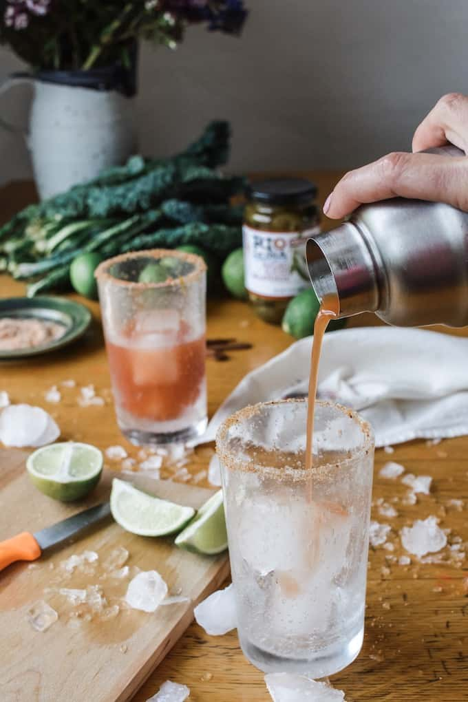 #ad|This is the best authentic Michelada beer cocktail you will ever try, flavored with fiery pickling liquid from the peppers and a whole pile of jalapeños and lime. #michelada #jalapenos #beercocktail #beer #spicycocktail