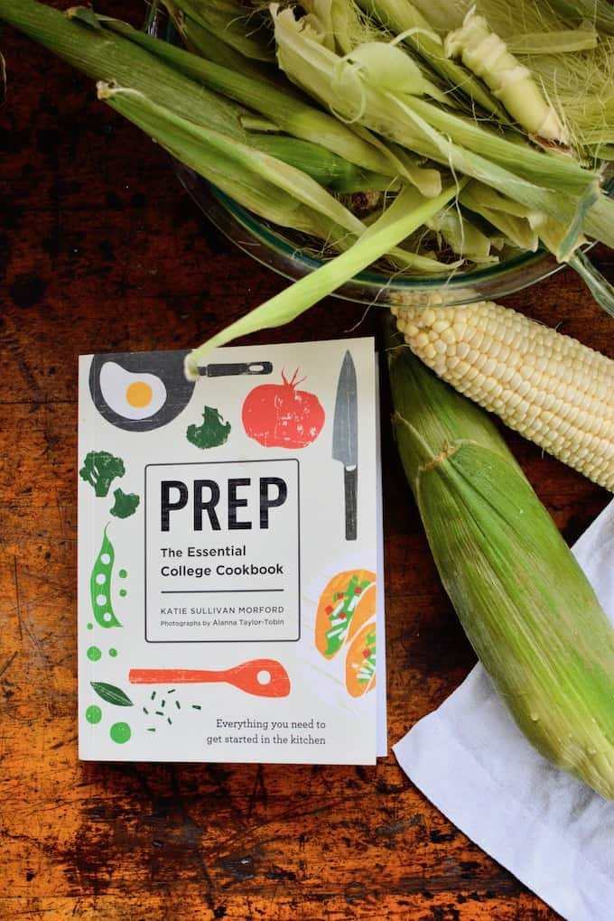 This Cilantro-Lime Corn, steamed and covered in cilantro butter and cotija, is the perfect summer side dish from Katie Sullivan Morford's new book, Prep. This is such a good book for a high school graduation gift.   #sweetcorn #streetcorn #cornonthecob #Mexicanstreetcorn