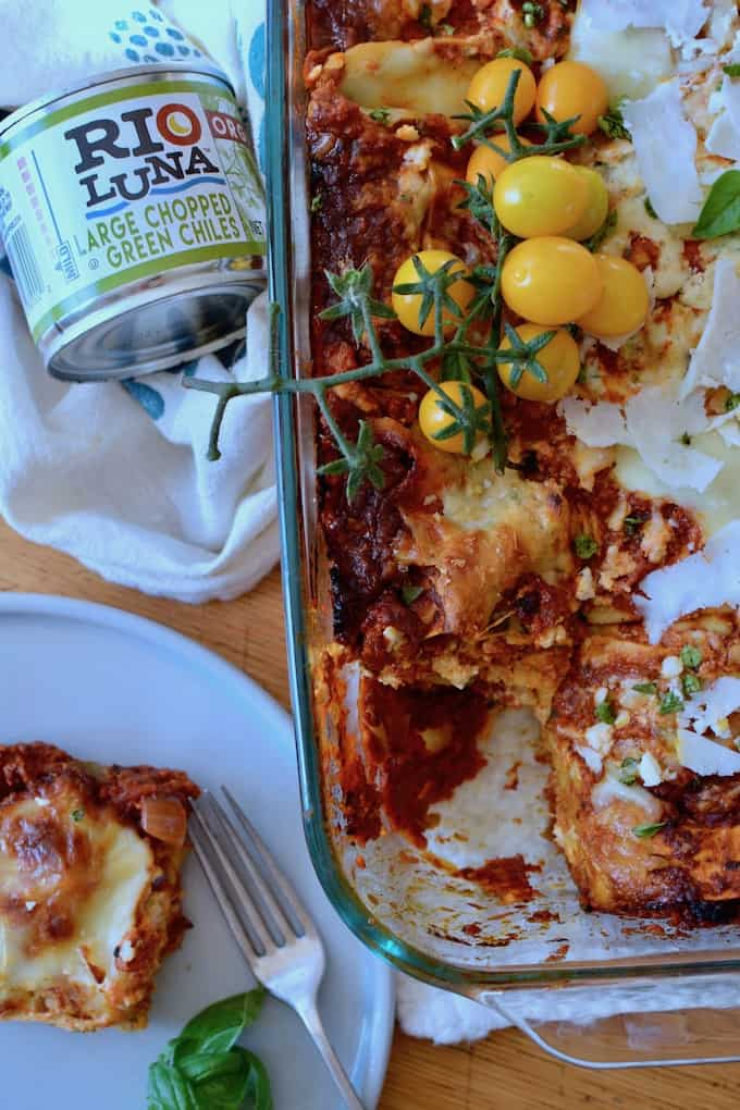 Layer upon layer of complete deliciousness with this Mexican Lasagna Recipe. Chorizo Bolognese, three kinds of Mexican cheeses, and no-boil noodles! #ad #holajalapeno #mexicanlasagna #riolunaorganic
