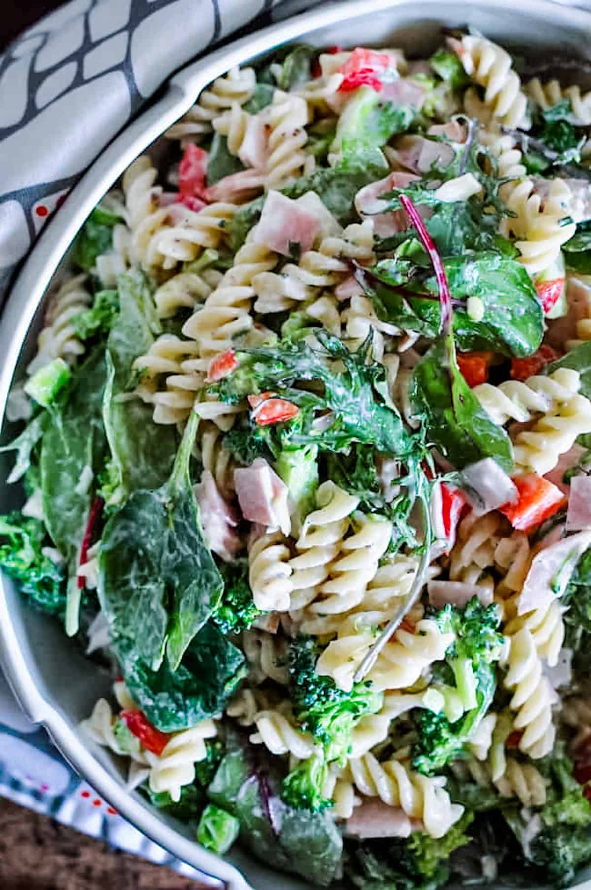 An image of leftover ham recipes using the ham to make pasta salad. This is a close up shot of pasta salad with broccoli.