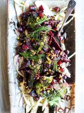 This Grape-Roasted Beet Salad with Serrano Pepper Dressing is a feast for the senses! Sweet, crunchy California grapes not only add texture and flavor to the final salad but also make a delicious marinade for the roasted beets. This is the salad that will elevate your next get-together. #beetsalad #spicysaladdressing #beetsaladdressing #ad