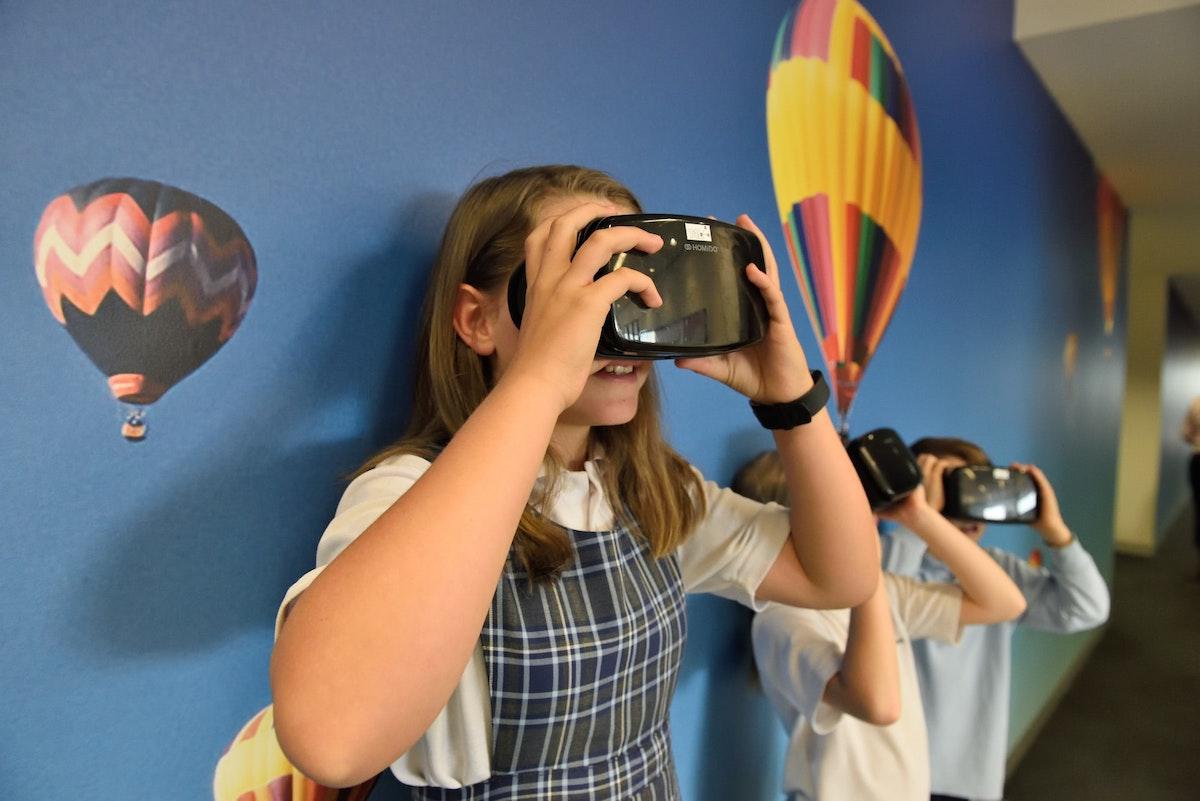 Girl learning on VR headset