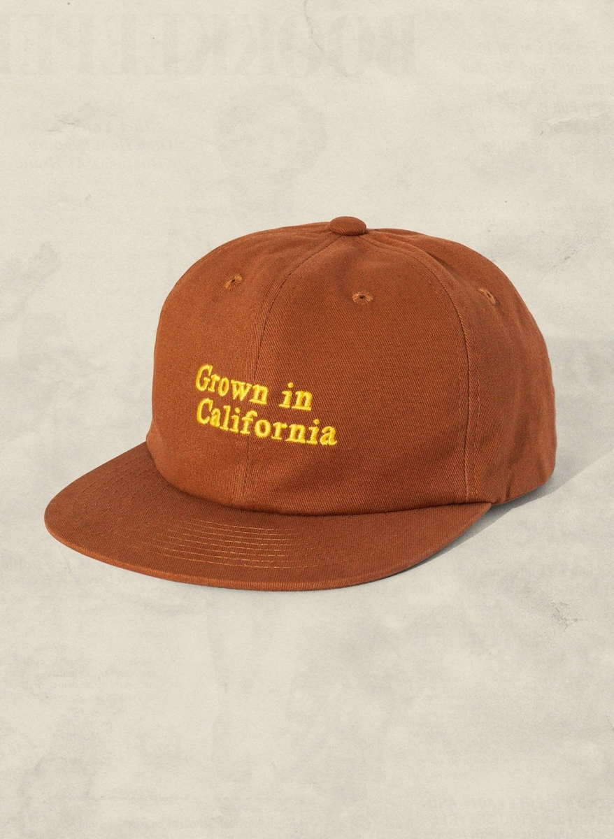 Grown in California hat in dark orange and yellow type