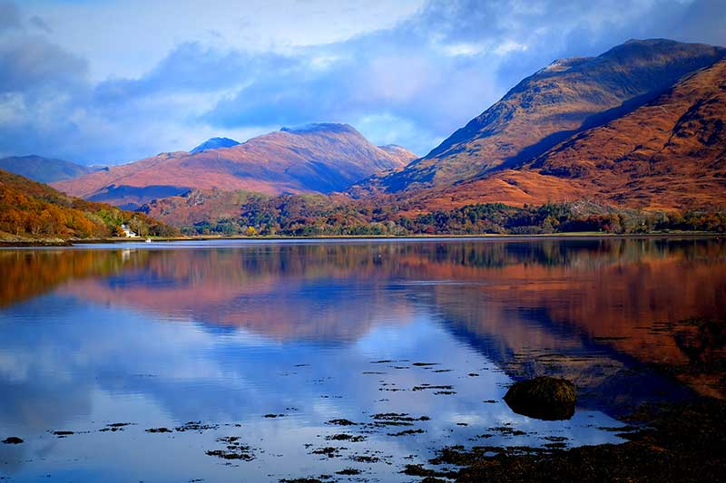 Port Appin things to do - Glen Creran towering over Loch Creran on a picture perfect day