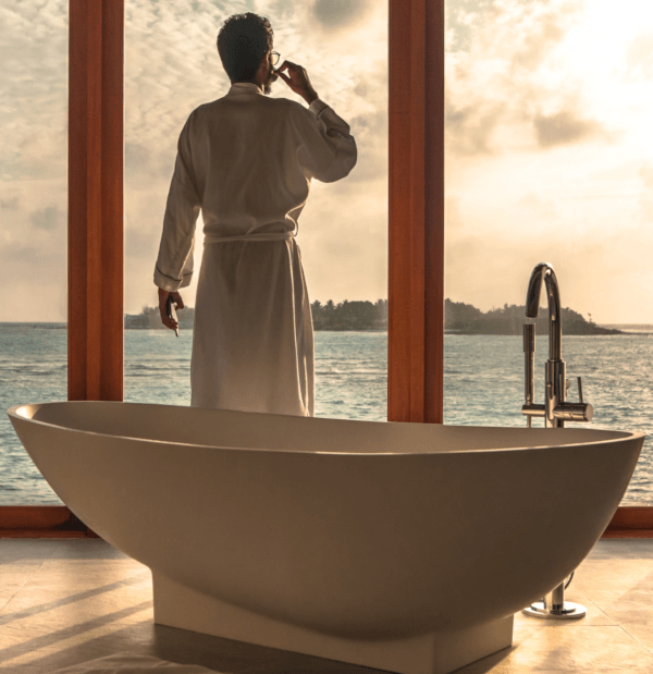 man standing near bathtub to do stress relief massages