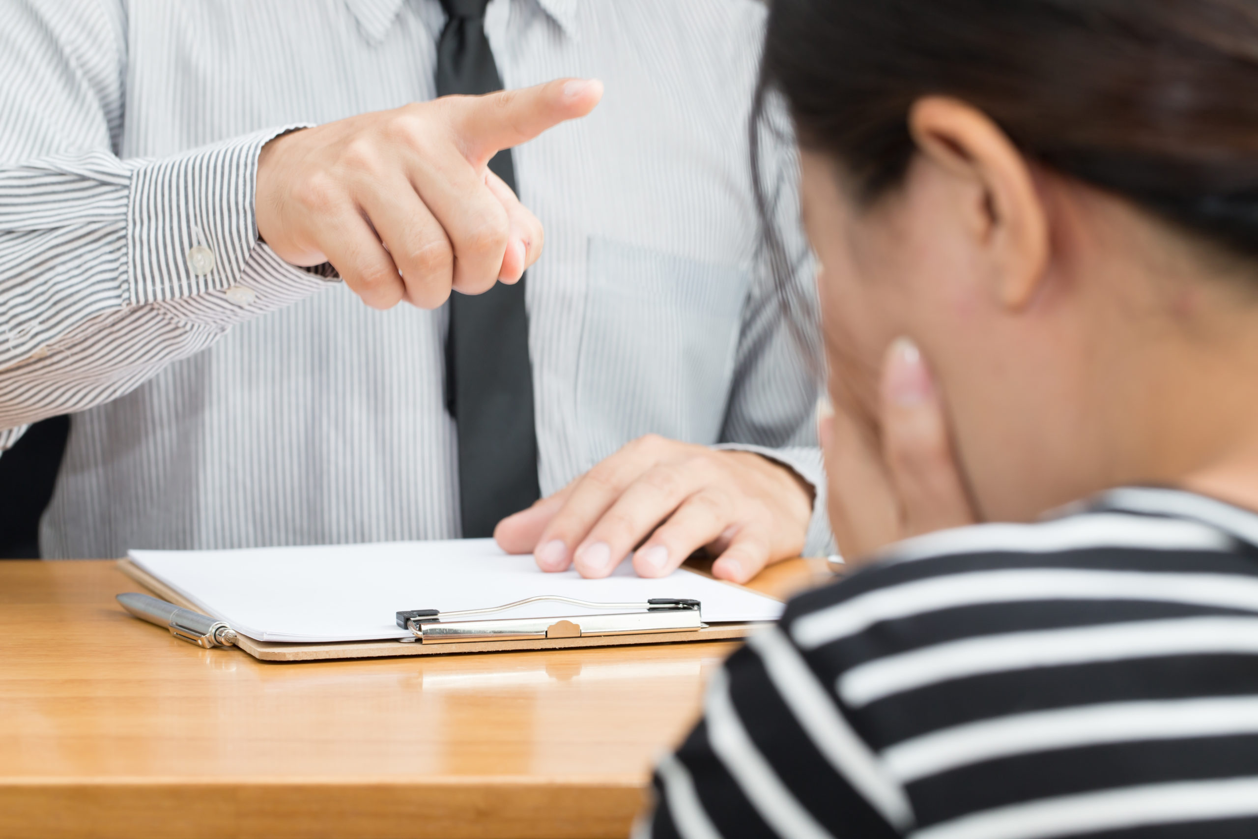 Businesswoman getting intimidated after scolded by boss and of need of conflict resolution