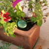 puck n flowerpot 720p Orgonite Garden Pucks
