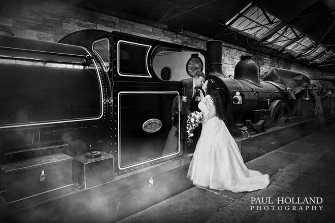 Image showing bride and groom with 0-4-0 2084 'FC Tingey' steam locomotive