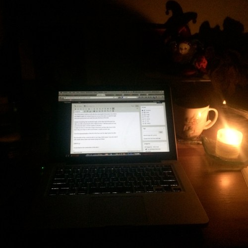 writing by candle light